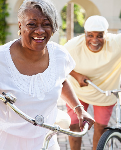 senior couple biking after endovascular surgery and a balloon angioplasty stent procedure