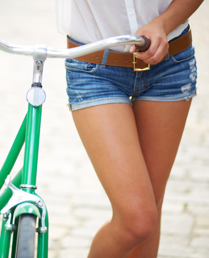 Girl riding bike after spider veins treatment