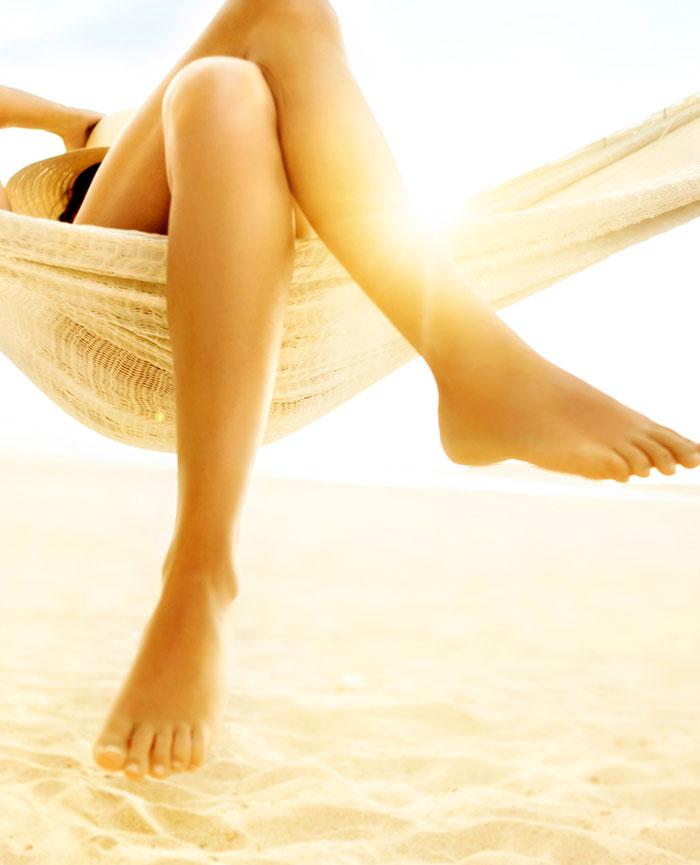 woman in hammock showing off spider vein-free legs