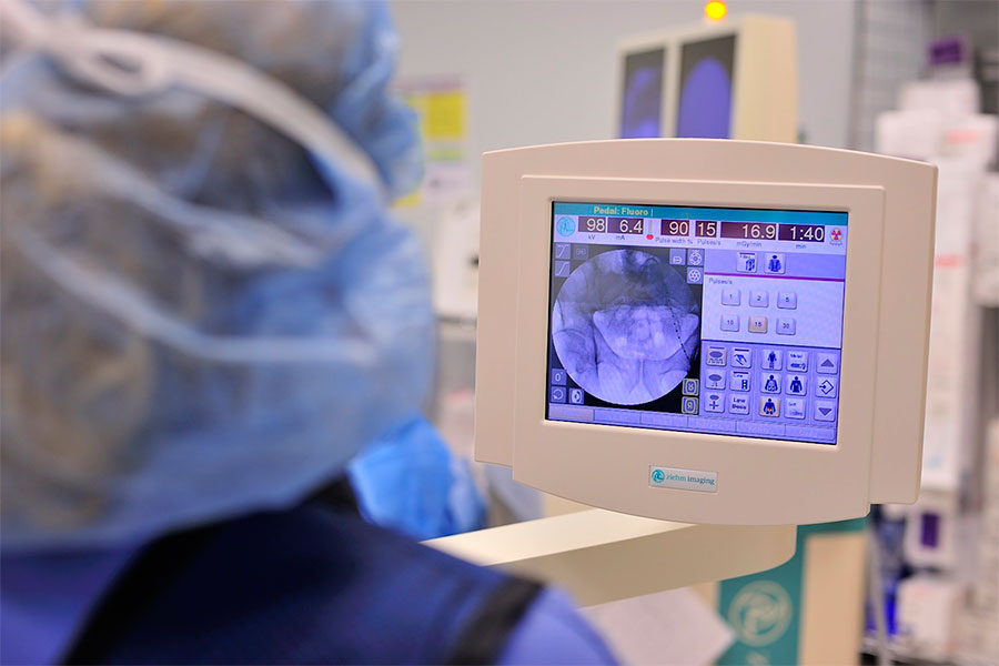 hernia surgeon reviewing scans in operating room