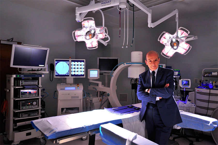 Hernia surgeon standing in private operating room at his hernia surgery center in Jupiter Florida