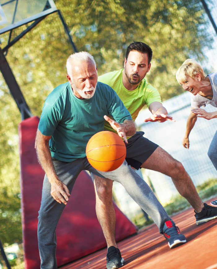 Family playing basketball after a successful endovascular aneurysm repair